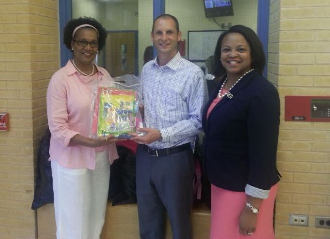 President Shena' Thornton and member Betty Yancey delivered backpacks for the students at Cary Elementary.